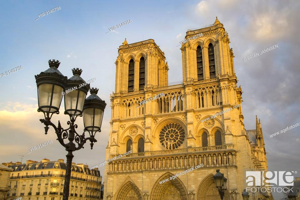 Stock Photo: Setting sunlight on the front facade of Cathedral Notre Dame, Paris, France.