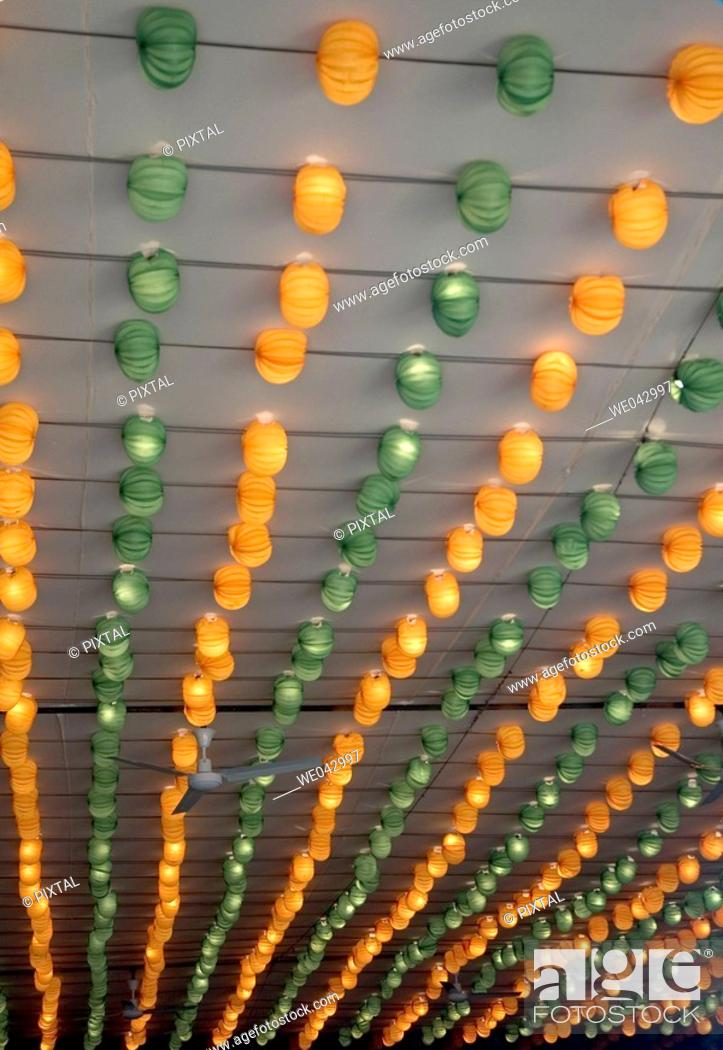 Stock Photo: orange and green lanterns fair booth.