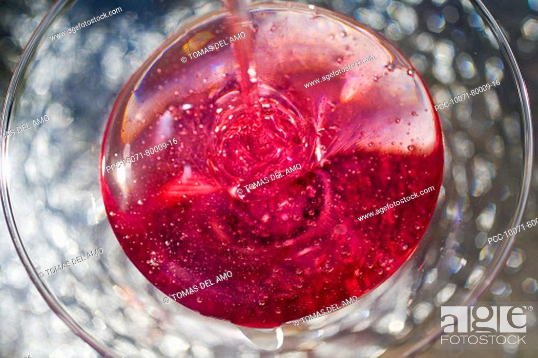 Stock Photo: Spa elements, absract view of pink liquid being poured into a glass.