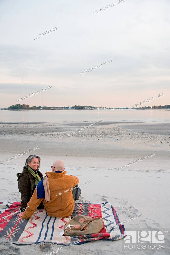 Stock Photo: Mature couple resting at the beach.