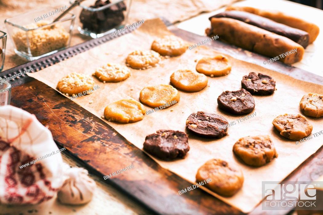 Stock Photo: Cookies on baking sheet near ingredients.