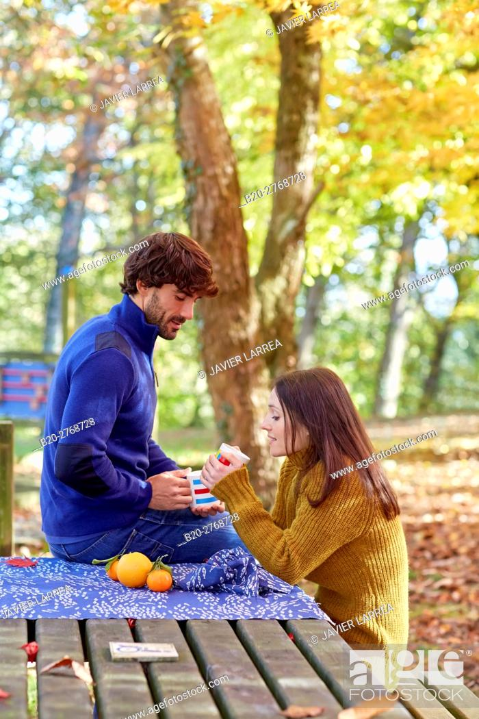 Stock Photo: Couple picnic in the forest, Autumn, Pagoetako Parke Naturala, Pagoeta Natural Park, Aya, Gipuzkoa, Basque Country, Spain.