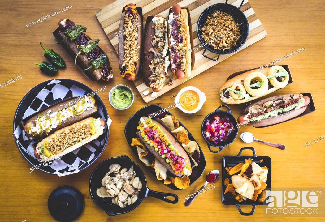 Stock Photo: Flat lay of great amount of delicious food of hot dogs and snacks.