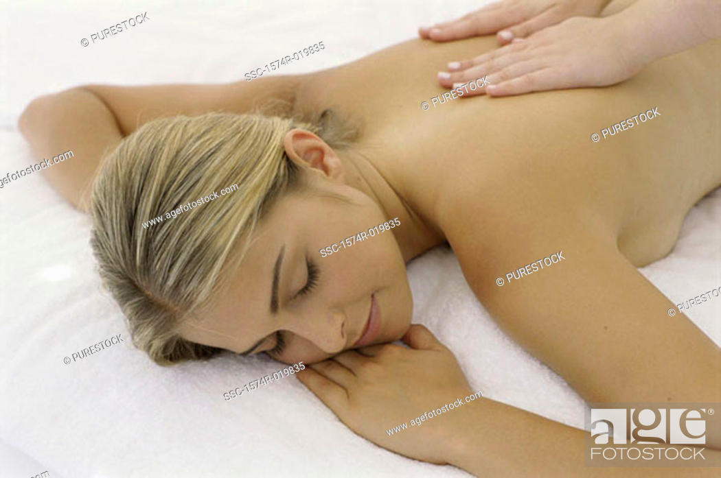 Stock Photo: High angle view of a young woman getting a back massage.