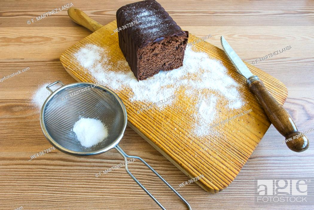 Stock Photo: Homemade chocolate cake on a wooden board.