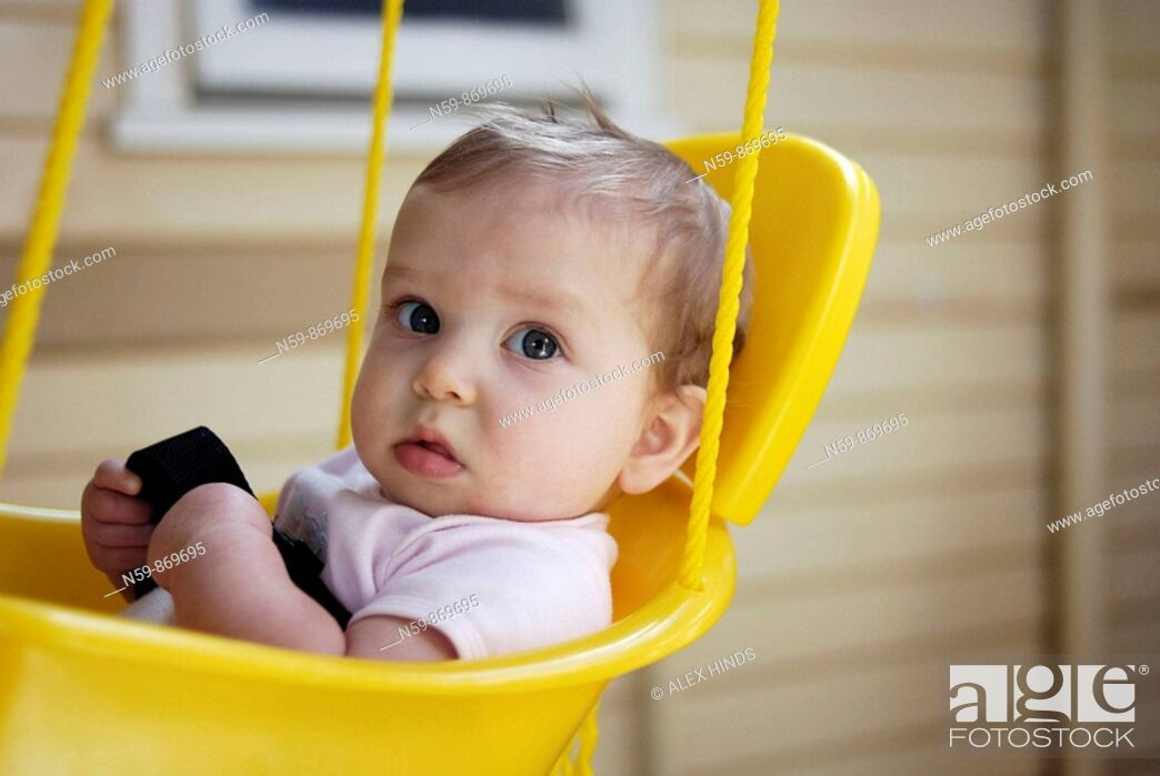 Stock Photo: Eight month old baby in swing.