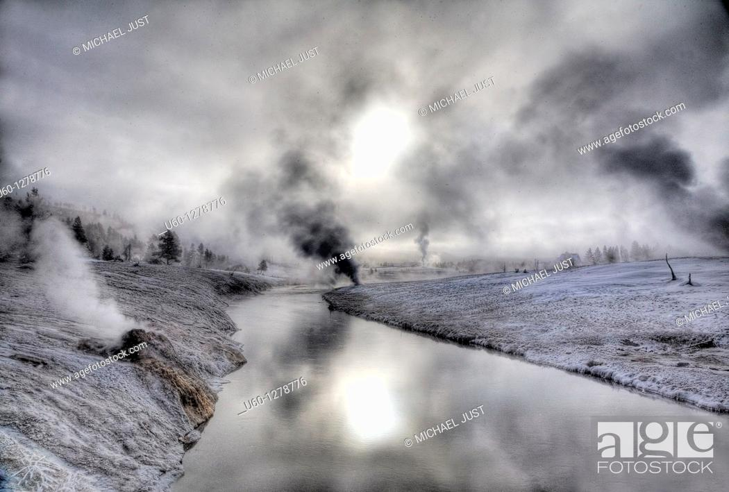 Stock Photo: A cold winter morning produces frost and steam along the Firehole River at the Upper Geyser Basin at Yellowstone National Park, Wyoming.
