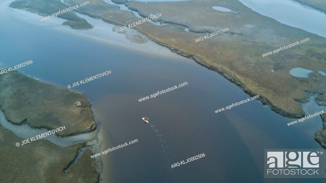 Stock Photo: Aerial view of paddleboarder surfing in Scarborough Marsh, Maine, USA.
