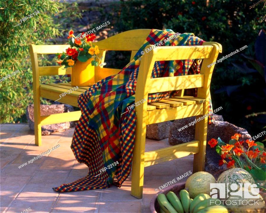 Stock Photo: Garden seat with flowers and fruits.