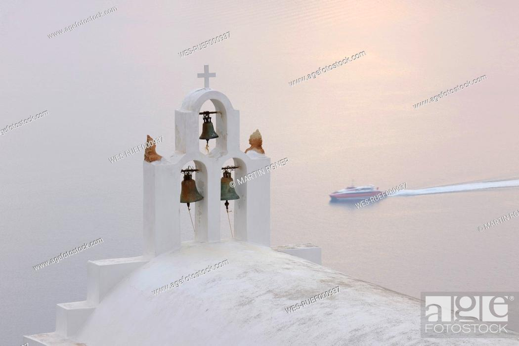 Stock Photo: Greece, Bell Tower of whitewashed church in Imerovigli at Santorini.