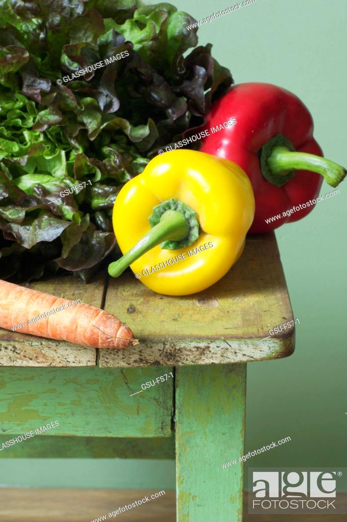 Stock Photo: Fresh vegetables on an old table.
