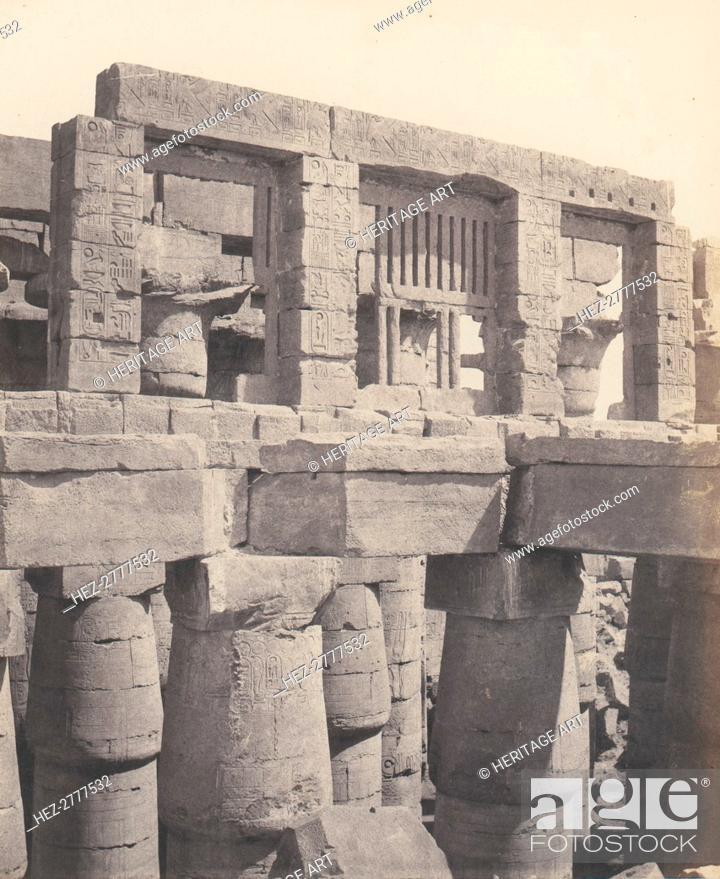 Stock Photo: Karnak (Thèbes), Palais - Salle Hypostyle - Fenêtre et Chapiteaux des .., 1851-52, printed 1853-54. Creator: Félix Teynard.