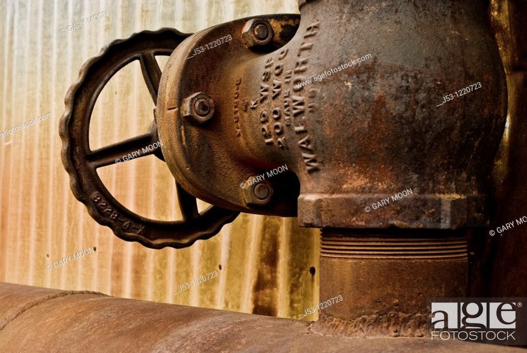 Stock Photo: Old rusty pipe valve on abandoned steam plant.