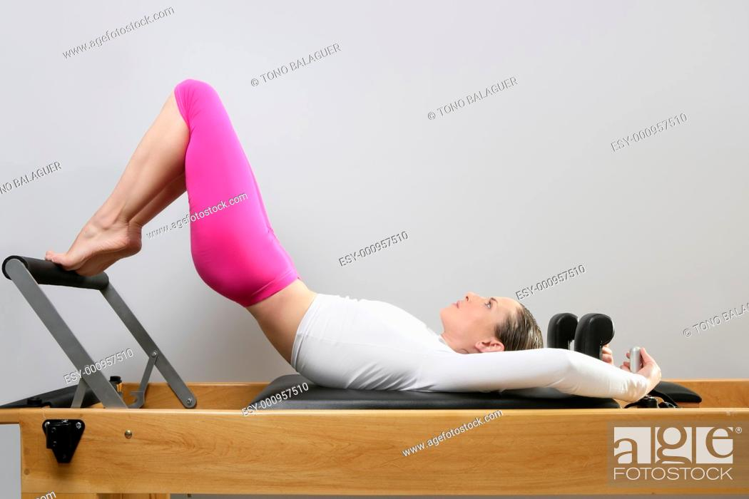 Stock Photo: pilates reformer woman gym fitness teacher legs exercise.