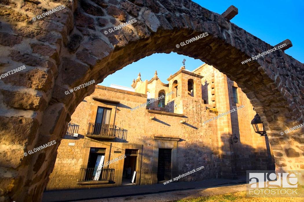 Stock Photo: Church viewed through an arch, Templo De Las Rosas, Morelia, Michoacan State, Mexico.