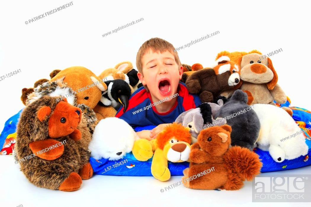 Stock Photo: boy in bed with toy animals, studio, Oetwil am See, Zuerich, Switzerland.