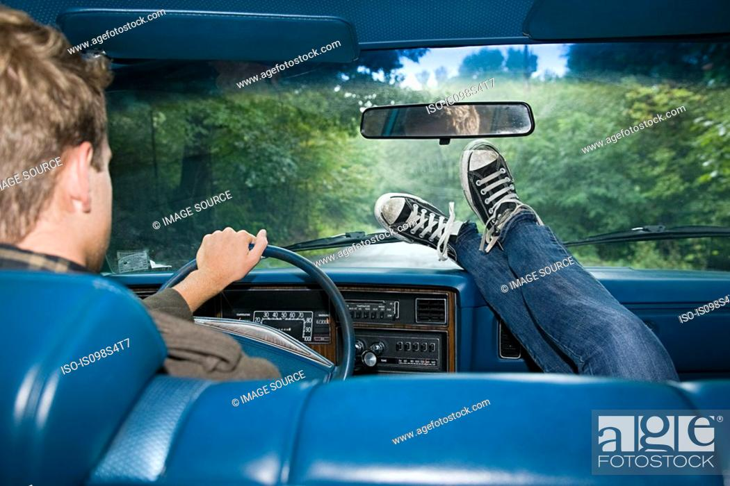 Stock Photo: Young people in car.