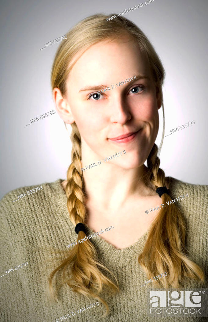 Stock Photo: Young girl in braids smiling.
