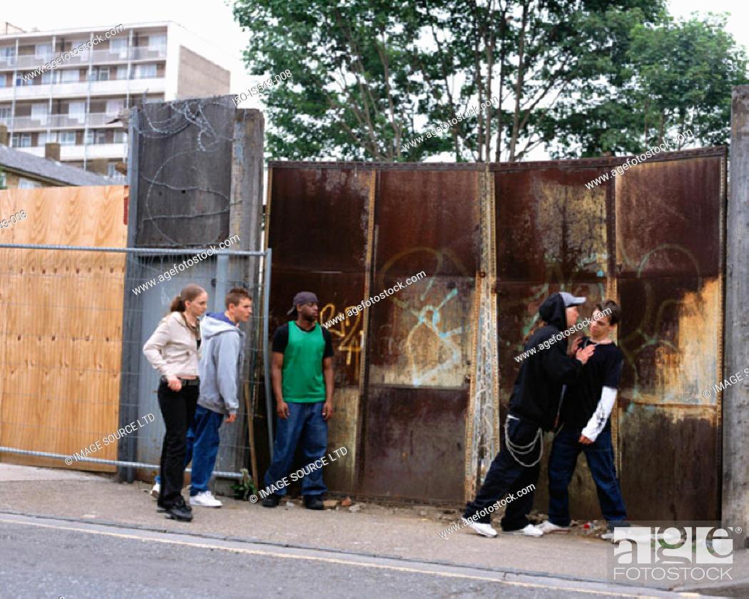 Stock Photo: Teenager boys fighting.