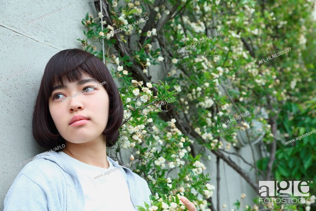 Stock Photo: Young Japanese woman portrait outside.