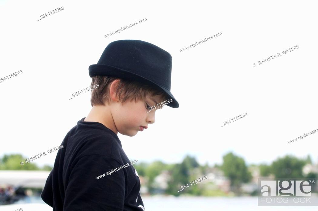 Stock Photo: Profile of a ten-year-old boy wearing a hat outdoors.