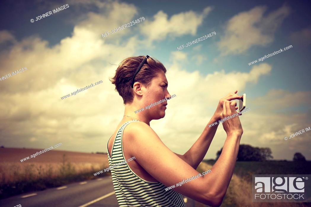Stock Photo: Woman taking picture.