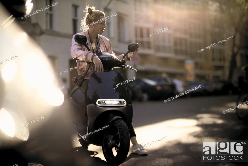 Stock Photo: Woman on motor scooter, in Berlin, Germany.