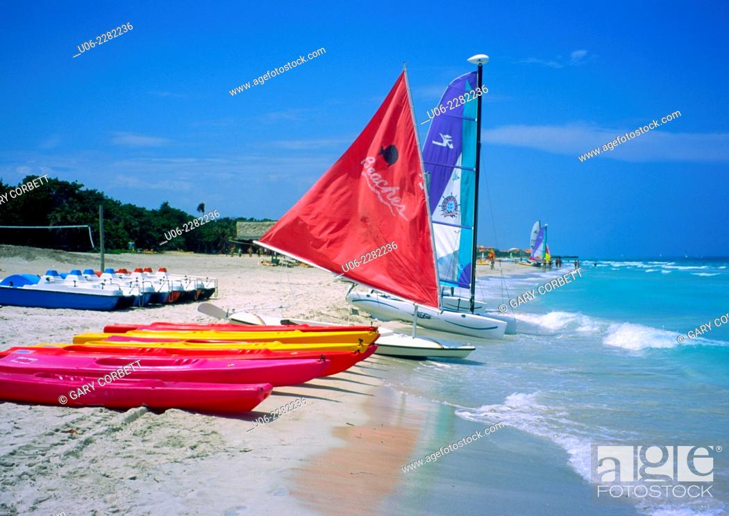 Stock Photo: Varadero Beach at Varadero, Cuba showing sailboats and kayaks, sand and surf.
