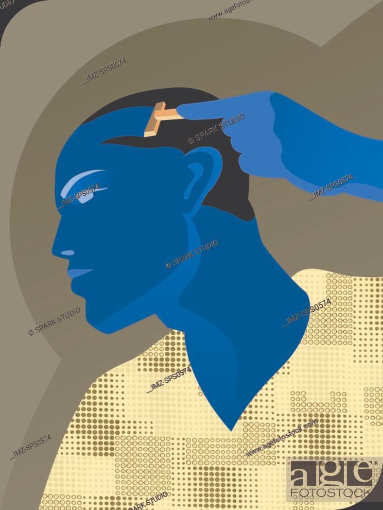Stock Photo: A man shaving his head.