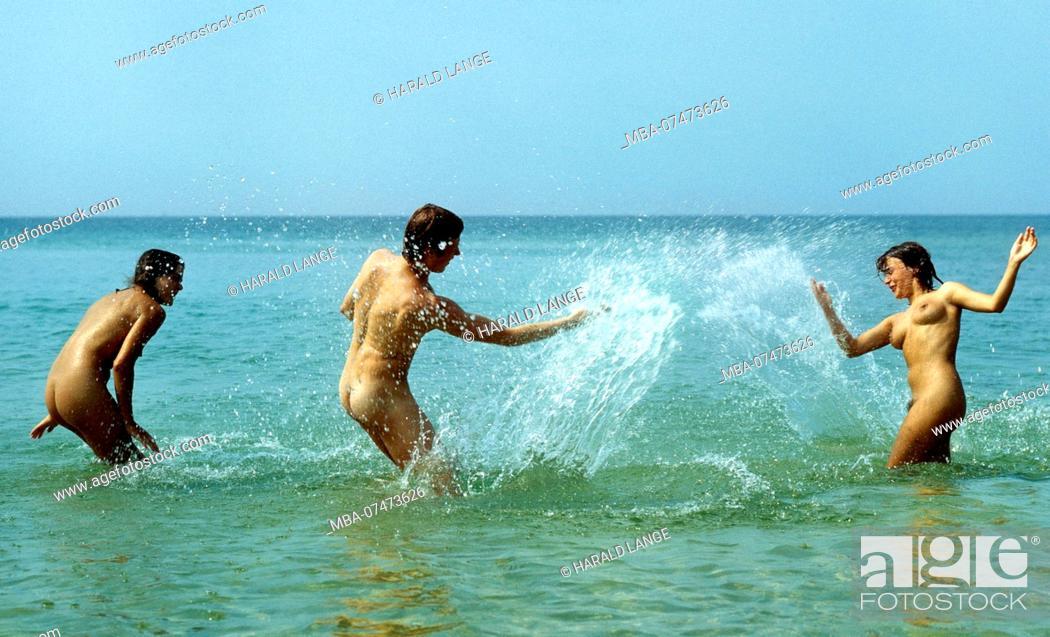 Stock Photo: Bathing fun on the Baltic Sea Nudist beach Prerow on the Darss.