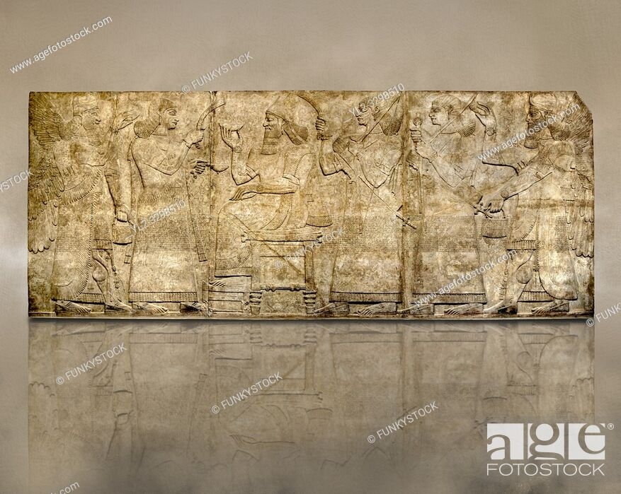 Stock Photo: Assyrian relief sculpture panel of King Ashurnaspiral II enthroned between two attendants. The group is flanked by winged protective spirits.