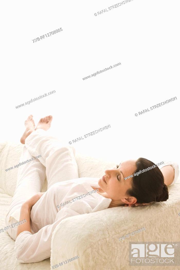 Stock Photo: woman relaxing on sofa.