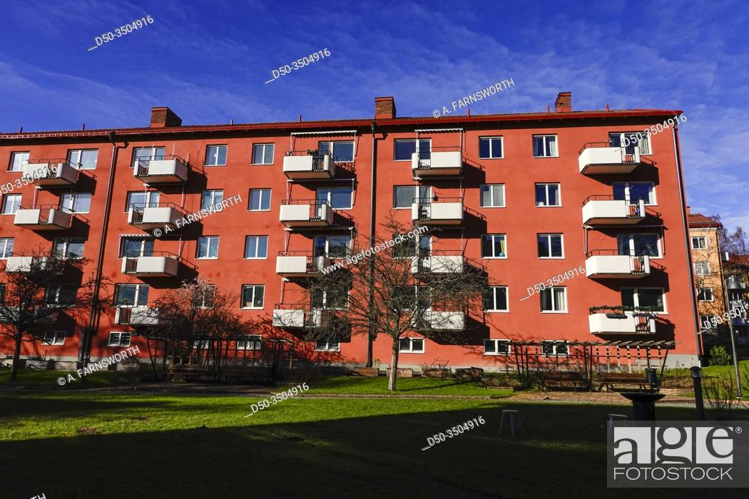 """Stock Photo: Stockholm, Sweden An old """"""""funkis"""""""" style red apartment block in Aspudden on Vapengatan."""
