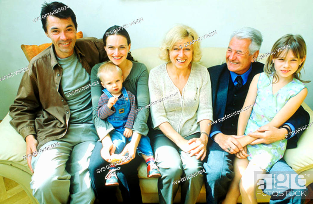 Stock Photo: Portrait of a family sitting on sofa.