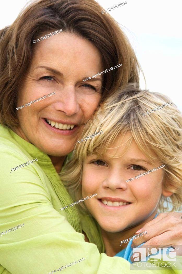 Stock Photo: Woman hugging her grandson and smiling.