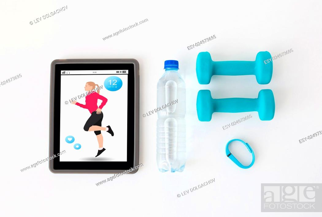 Stock Photo: sport, healthy lifestyle, fitness and technology concept - close up of tablet pc computer with dumbbells, fitness tracker and water bottle over white background.