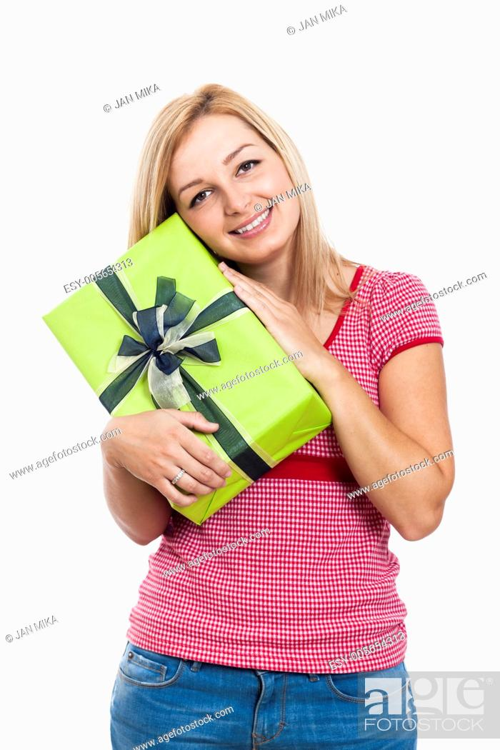 Stock Photo: Young happy woman holding present, isolated on white background.