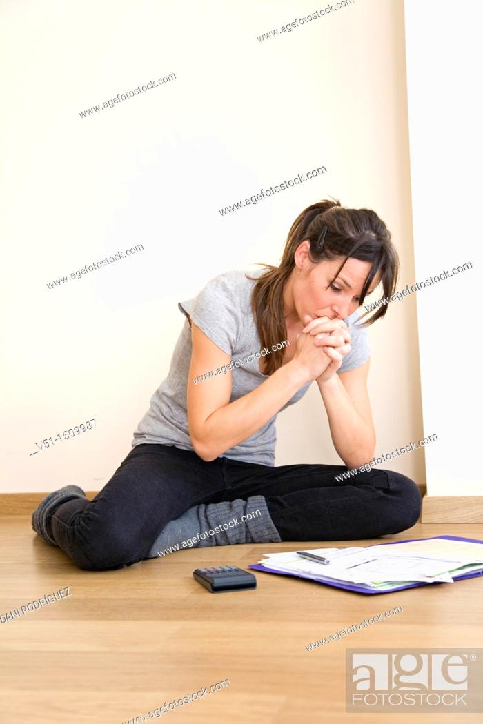 Stock Photo: Young woman bookkeeping.