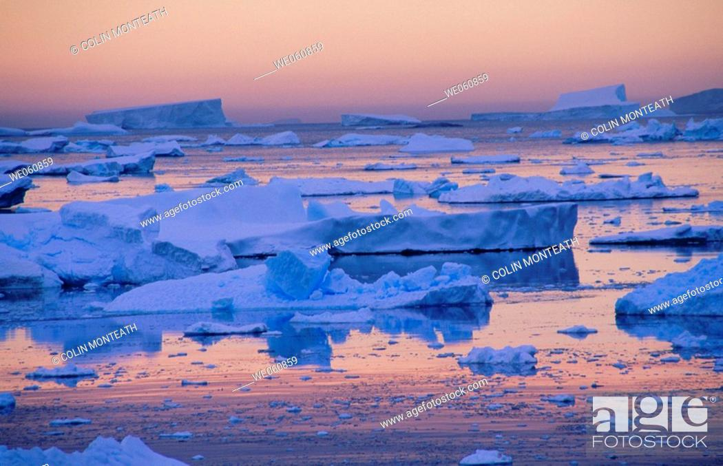 Stock Photo: Icebergs and pack ice. South of the Lamaire Channel. Antarctic Peninsula. Antarctica.