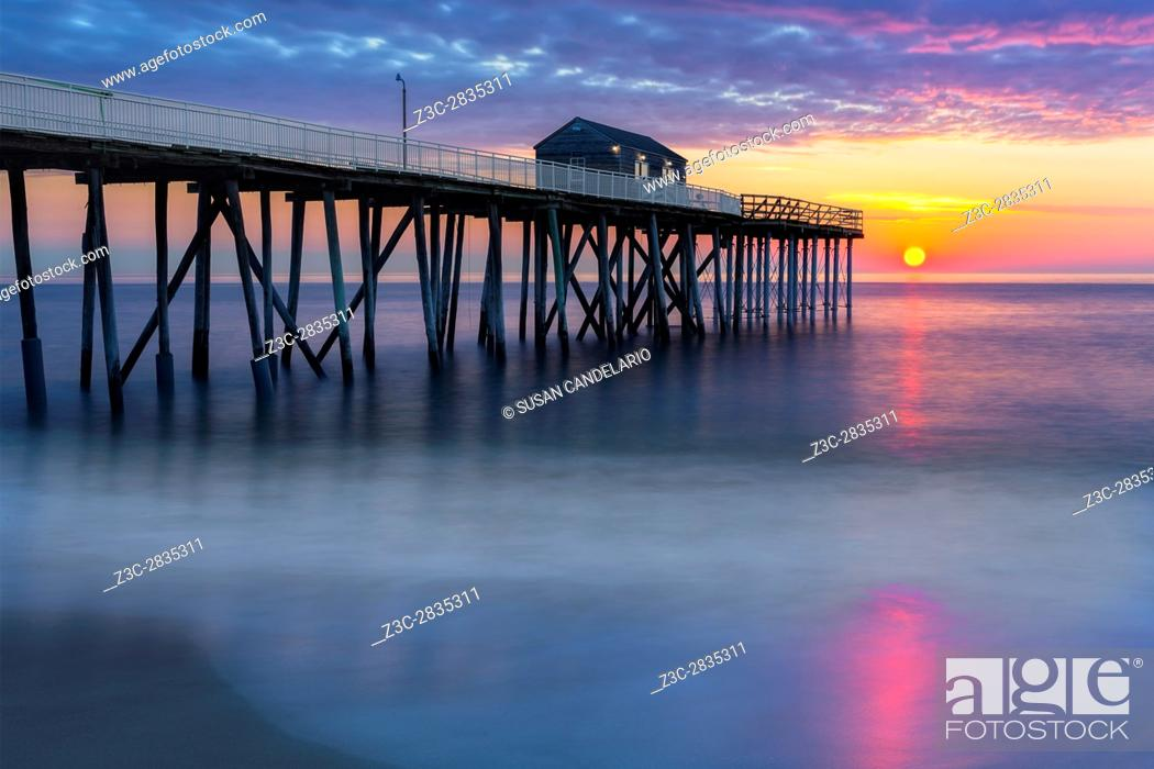 Stock Photo: NJ Shore Pier Sunrise - Dramatic and beautiful colors surround the Belmar Pier at the New Jersey Shore during this beautiful seascape sunrise.