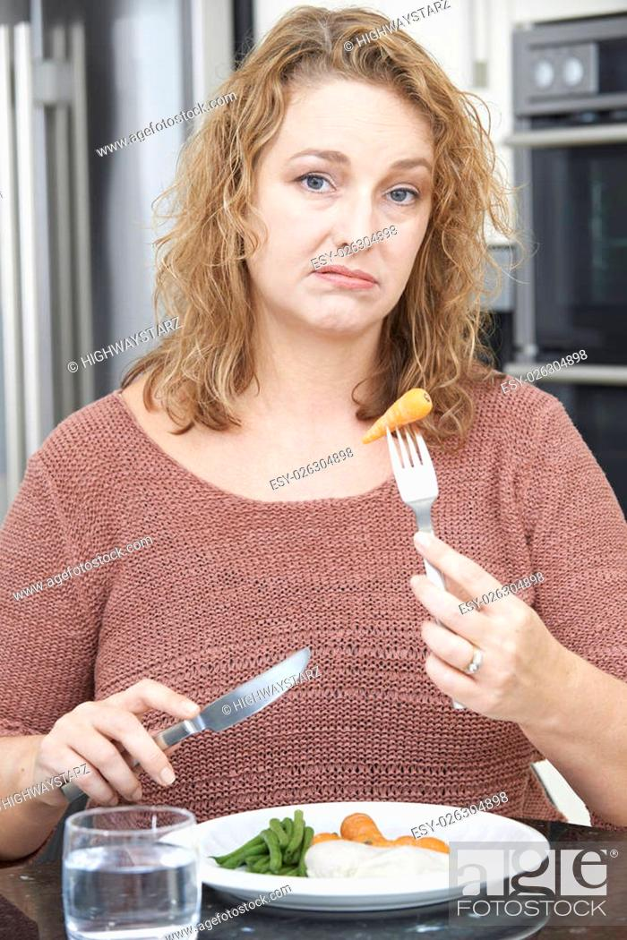 Stock Photo: Woman On Diet Fed Up With Eating Healthy Meal.