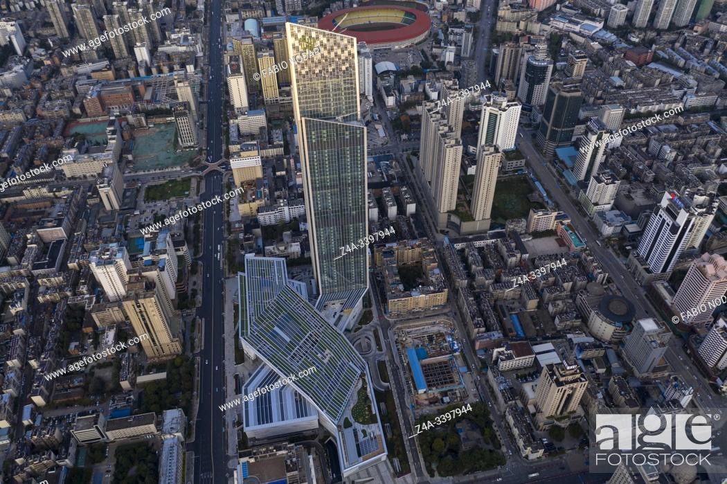 Stock Photo: Kunming, China. Aerial view of Kunming at sunset with the Spring City 66 skyscraper and mall on foreground.