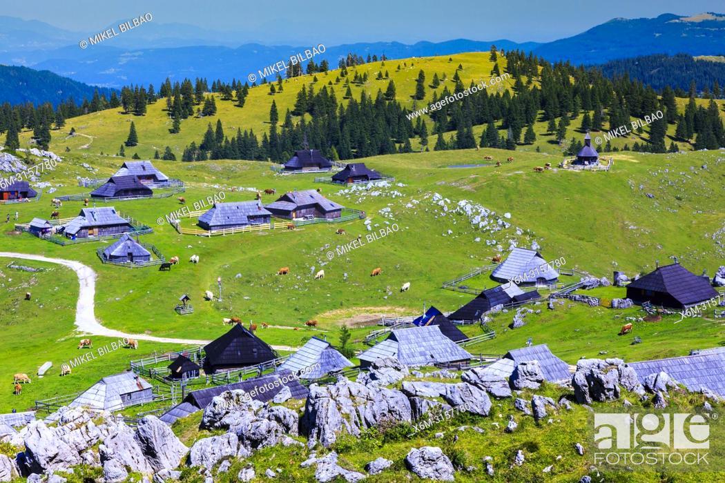 Stock Photo: Mountains in summer and huts. Velika Planina sky area. Upper Carniola region. Slovenia, Europe.