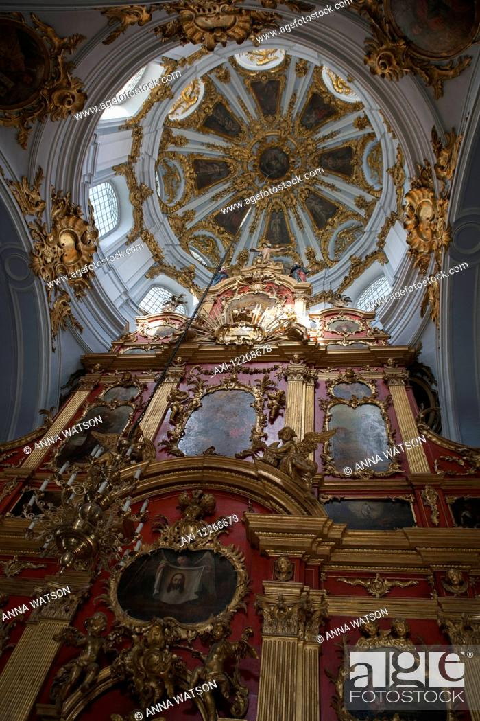 Baroque altar with cherubs and oil paintings St Andrew's