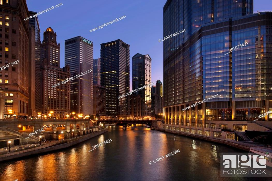 Stock Photo: Chicago River and downtown buildings at dusk.