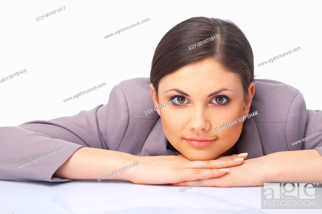 Stock Photo: Closeup portrait of young woman with her hands under her chin.