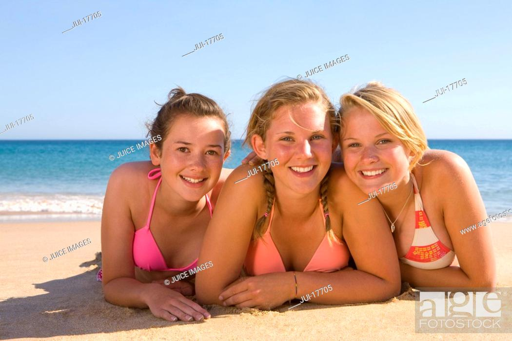 Stock Photo: Teenage girls posing on beach.