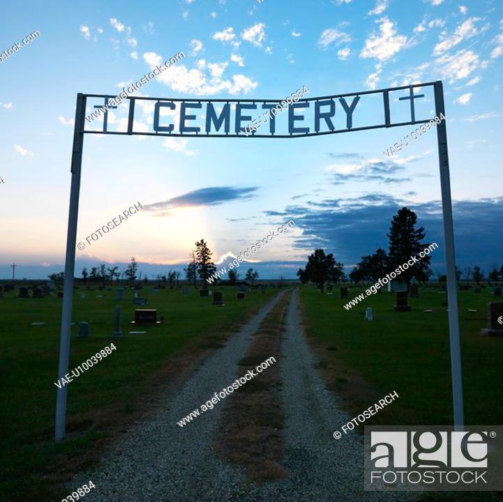 Stock Photo: Sign over entrance to cemetary at dusk in rural South Dakota.