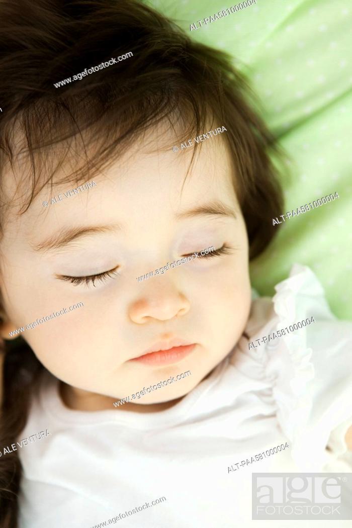 Stock Photo: Baby girl sleeping, portrait.