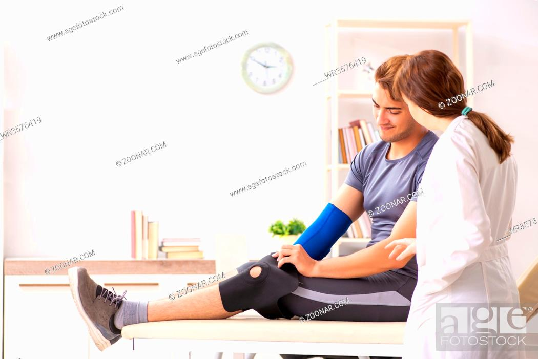 Stock Photo: Young male patient visiting female doctor traumatologist.